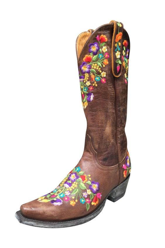 "Handcrafted in a rich, distressed chocolate leather that is soft to the touch, this beautiful boot features embroidered bouquets of flowers in purple, lavender, pink, red, orange, yellow, gold, green, and blue threading. The embroidery surrounds the vamp, counter heel, top, and side pulls. Pair these with anything from black, white or blue jeans to summer dresses. Soft calf leather lining. Leather insole and outsole. Lemon wood hand-pegged.    Shaft height: 13"". Stacked leather heel: 1.5""…"
