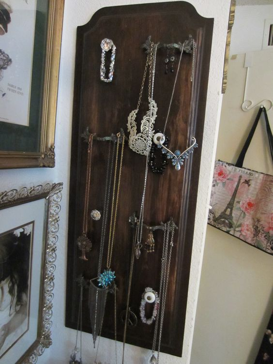 Jewelry Organizer  - Used a cabinet front that I did a brown wash on and old drawer pulls& crystal & porcelain knobs to hang the jewelry.