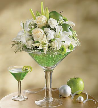I did something similar for a ladies event recently. We did cosmo inspired centerpieces in martini glasses. So fun!