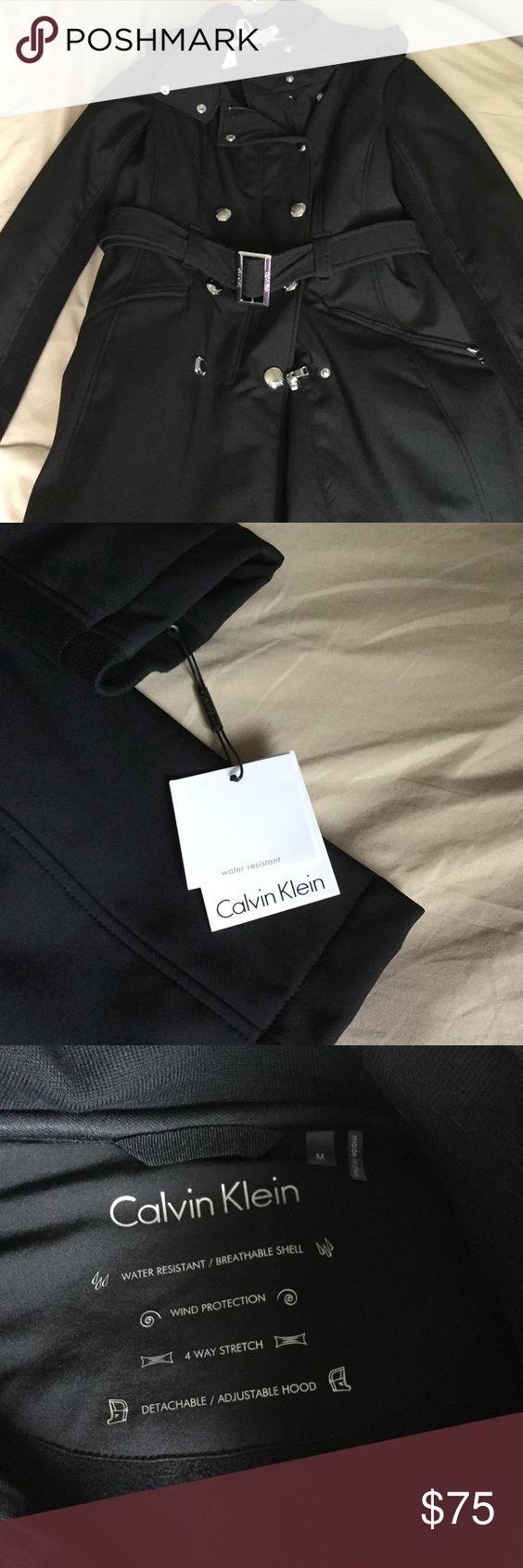 NWT Calvin Klein Coat New Calvin Klein Asymetrical snap collar coat. Stretchy material size Medium Calvin Klein Jackets & Coats Trench Coats