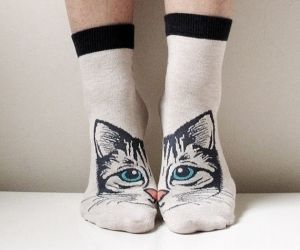When you're not knee deep in actual kittens, a girl needs a way to keep her feet warm. Show your crazy cat lady pride with these socks. One size fits all, unless they don't.