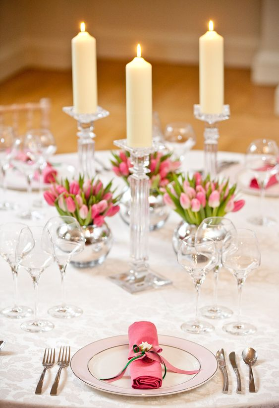 the mini tulips are so adorable. This seems very do-able as well, but lots of glass... would you be able to borrow from coordinators or other people who are helping plan this? This centerpiece would be very cute set on a mirror as well.