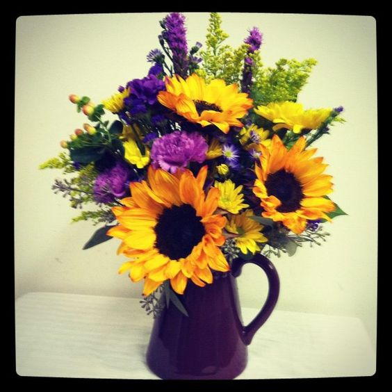 Sunflower arrangement of purple and yellow by Bev's Floral & Gifts ...
