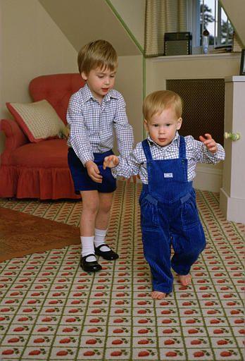Prince William teaching Harry how to walk 1985.... He has got it !!!