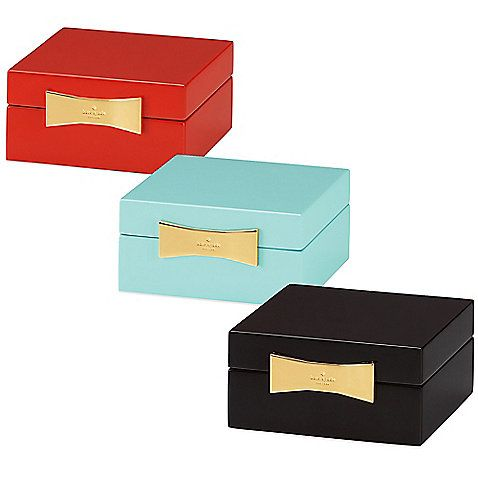 The brightly colored kate spade new york Garden Drive Jewelry Box is perfect for keepsakes, jewelry, or anything that needs chic but safe keeping. Velvet lined and features the signature kate spade new york bow closure, and rich gold hardware.