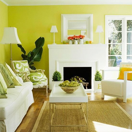 love all the varied shades of green paired with crisp white in this sitting room