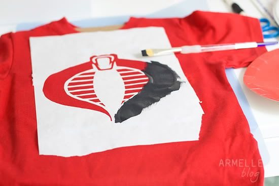 If you're looking for a fun craft project to do with your kids once school is out, try this step-by-step for creating graphic t-shirts using freezer paper stencils from Armelle.