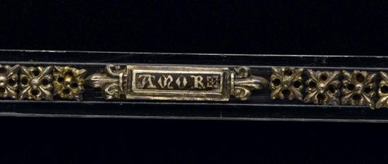"""Belt (Treasure of the Colmar): ca. 1340-1349, From the Southern Rhine Region (possibly), silver, enamelled and gilded, translucent fragment silk. Inscribed """"Amor"""" (love), """"Lieb"""" (life), """"Hail"""" (health), """"Anch,"""" which probably referred to a name, perhaps Angel, Hanchen, or Annchen. (Part of the Orfèvrerie et ivoires Collection.)"""
