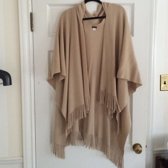 Fringe trim poncho with hood Women's camel colored fringe trim poncho with hood. SUPER CUTE and goes with everything!!! Easy to throw on and dress up or down Jackets & Coats