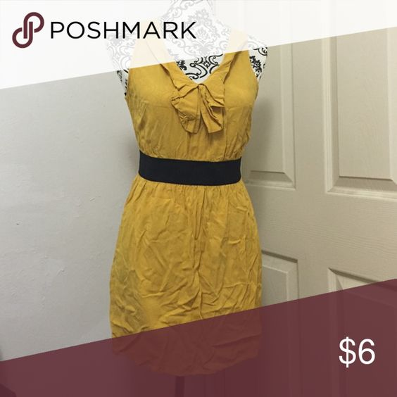 Yellow Gold Forever 21 dress size M Very cute for all occasions! A Forever 21 dress size medium. With a black band that sits below the bust line. Sitting in my closet for so long hence all the wrinkles. Adorable with a cardigan or blazer. Forever 21 Dresses