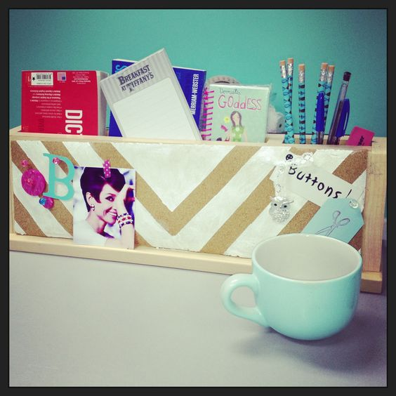 This organizer thingy came with the shelves we got from a Direct Buy that was closing.  It served a purpose but was so boring and bulky.  I gave it a makeover by adding cork board to one side and painting a design on it.  It isn't perfect but I'm happy with how it turned out.  The mug in front is intended for my Mommy chocolates (the good kind!).