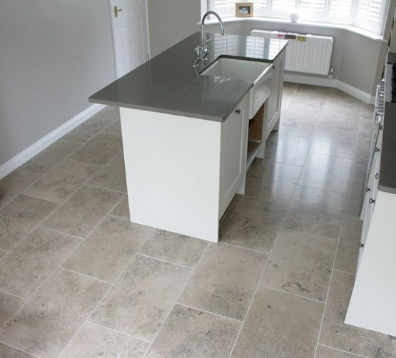 Small Kitchen With Grey Limestone Floor Tiles Flooring Ideas Floor Design Trends Tile Floor Floor Tile Design Trendy Kitchen Tile