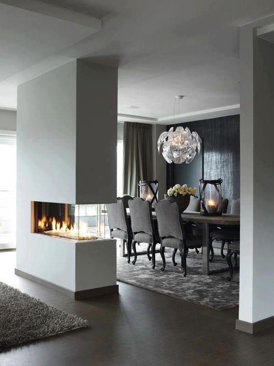 Great dividing wall beautiful feature fireplace for Cheminee interieur moderne