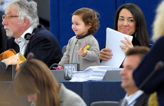 Age 8 is the when daughters stop thinking about being leaders. Bet this would fix that. Here's the deal. European Parliament allows you to bring your child to work. Licia Ronzulli's daughter, Victoria, is taking advantage of that.