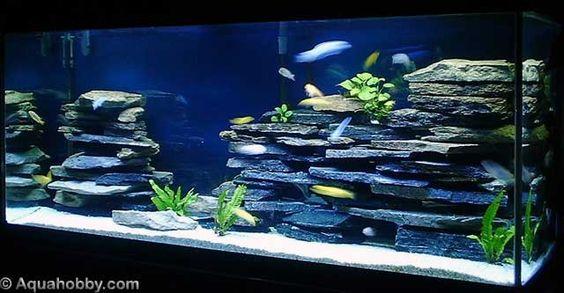 cichlid tank landscape using aquarium safe silicon and flat slate rocks