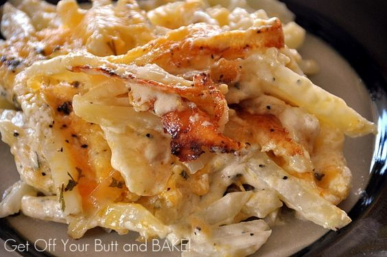 CREAMY CHEESY POTATOES About 5 – large potatoes *enough to fill a 9×13 glass baking dih  1 pint whipping cream- 2 cups Salt and Pepper  2 tsp. Parsley flakes  2 cups grated cheddar cheese