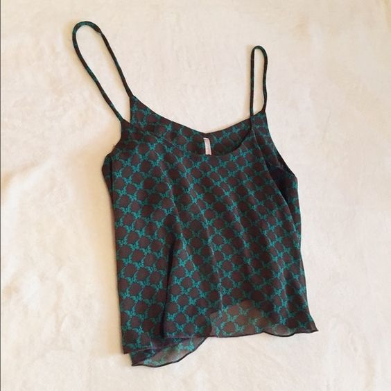 Crop Tank Top Flowy crop tank top in a soft blouse material. Color is a dark brown with a turquoise butterfly pattern. Worn once & in great condition. Michelle Tops Tank Tops