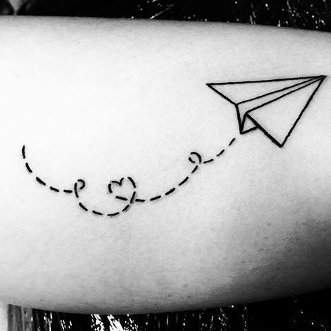 Tattoo History And What They Mean Today Paper Airplane Tattoos Airplane Tattoos Small Feminine Tattoos