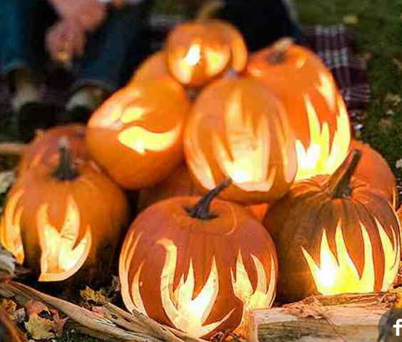i Like this! Flames  added to pumpkin to appear as if they are in a bonfire!