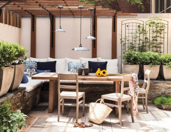 Contemporary Outdoor Dining Area with Porcelain Pendants: