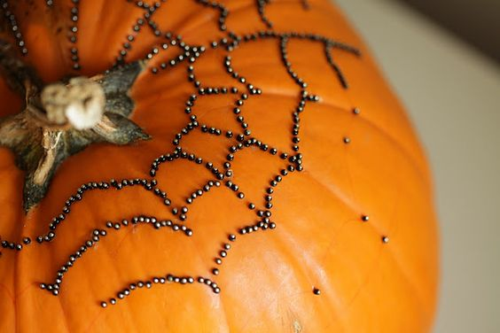 takes forever...but very cool idea - make a spider web on your pumpkin with push pins