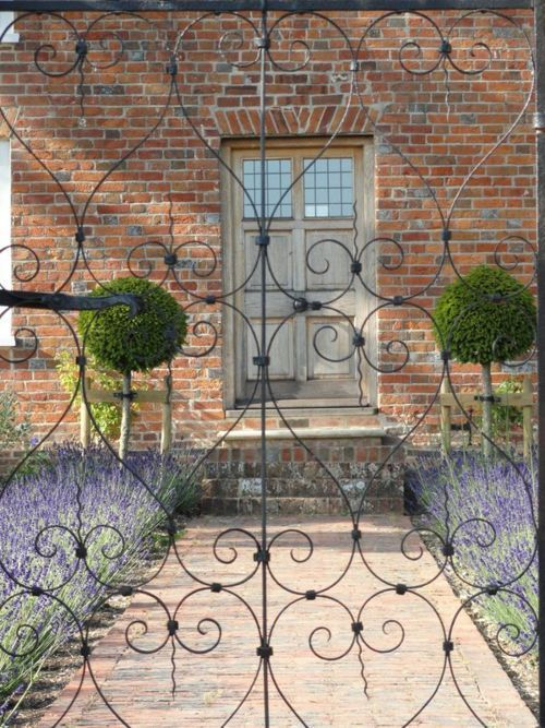 lavender path and lollipop topiary - perfect French garden detailing from How To Choose The Perfect Front Door Colour For Red Brick Houses over on Modern Country Style