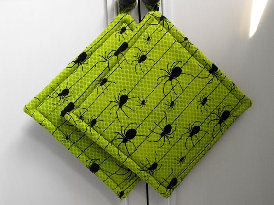 Set of Two Halloween Pot Holders/ Spiders/ Green and Black/ Green/ Black/ Decor/ Kitchen/ Table. $12.00, via Etsy.