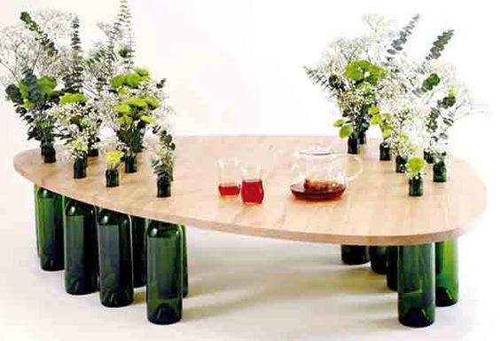 Brilliant. Wine bottle tables: Brazilian designer Tati Guimarães created Dvinus as an interactive user experience that forces owners to reuse otherwise disposable objects.