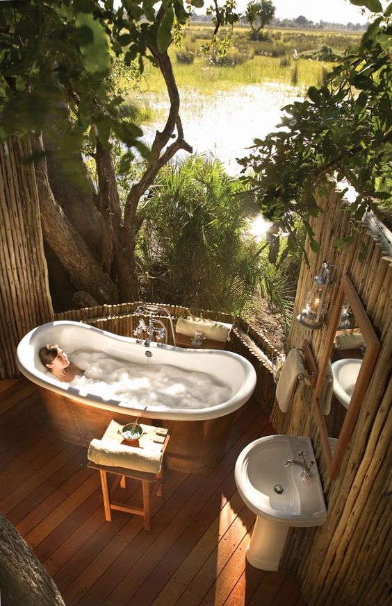 Remarkable rustic outdoor tropical bath with brown double slipper, bathtub chrome faucet, and hand shower. 10 Stunning Tropical Bathroom Décor Ideas to Inspire You ➤To see more Luxury Bathroom ideas visit us at www.luxurybathrooms.eu #luxurybathrooms #homedecorideas #bathroomideas @BathroomsLuxury