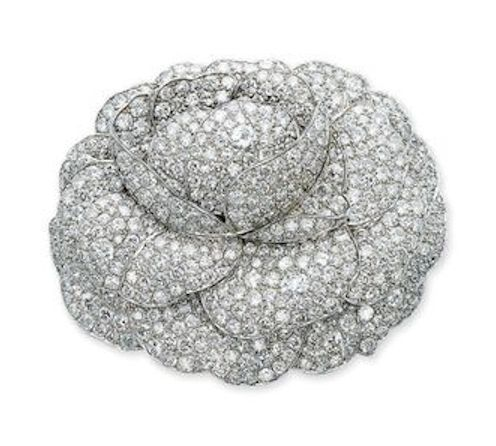 A DIAMOND CAMELIA BROOCH, BY BOIVIN  Designed as a pavé-set diamond open camelia, circa 1926, 6.9 cm wide, with French assay marks for platinum and gold By Boivin