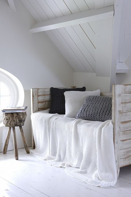 Sweater pillows make this daybed nook more inviting.