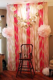 I really like the look of these streamers from twisted crepe paper. Blogger put a sheet behind them so you can't see through. Cute, easy, inexpensive. Streamer backdrop