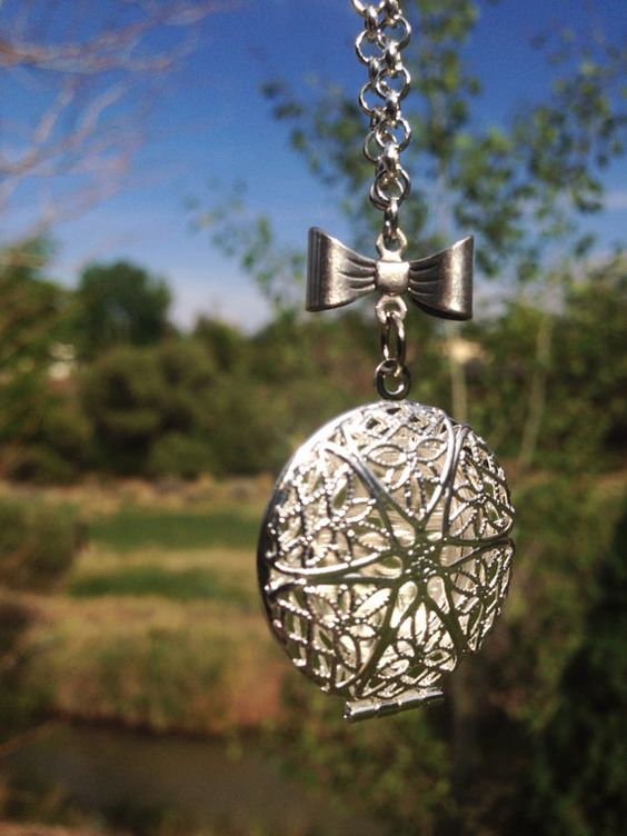 Bo Bow Silver Essential Oil Diffusing Necklace by OverYourHeart, $21.00