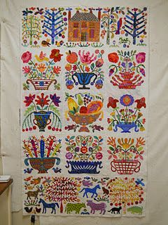 Glorious folksy appliqué. In my dreams I will do this. Maybe just a pillow or two to start.