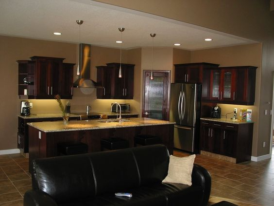 Wide open concept - Truly a mix of contemporary and modern with staggered upper cabinets and a large island.