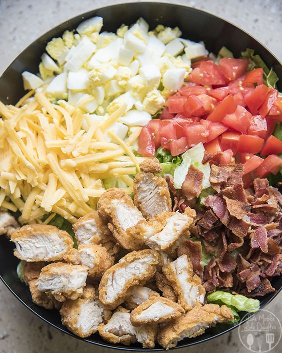 Crispy Chicken Cobb Salad - This cobb salad is packed full of sweet tomatoes, crunchy bacon, shredded cheese, boiled eggs, and crispy chicken. All topped with your choice of dressing for a delicious salad great for lunch or dinner!