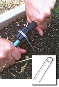 We've always used Earth Staples to keep soaker hoses in place. Recently, product developer Frank Oliver discovered that the wire loop of our Easy-Out Earth Staples fit perfectly into the hose connectors of the new Snip-n-Drip Soaker System. More on our blog  http://blog.gardeners.com/2012/07/a-perfect-match-for-snip-n-drip.html