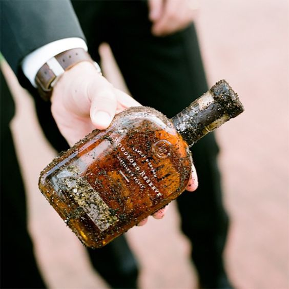 """In the words of Jen Fariello, """"How do you ensure amazing weather on your wedding day? You bury the bourbon of course!"""" Living in the Northeast, we'dnever heard of, or even been to a wedding where the bride and groomfollowed this tradition. Created to keep the rain away, the bourbon must be buried exactly one …"""