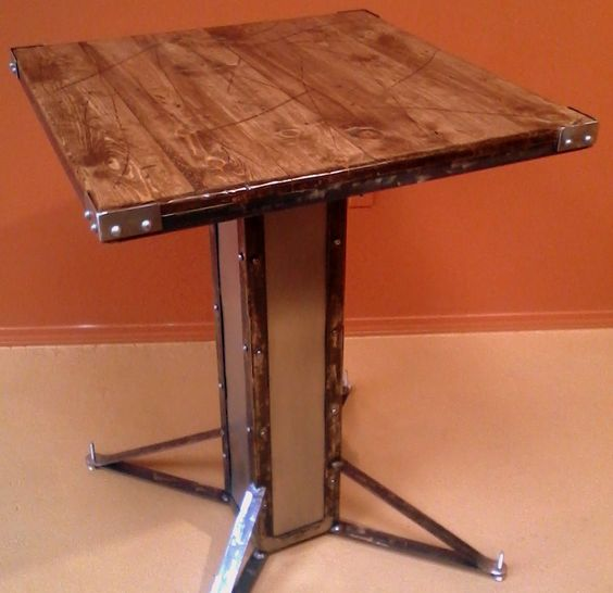 Oregardenworks Handmade Marketplace - Modern Industrial / Vintage Style Custom Bistro Table, Bar, Pub Height.  Custom Table with Rivets, Steel, Distressed Wood Top, $1,100.00 (http://www.oregardenworks.com/modern-industrial-vintage-style-custom-bistro-table-bar-pub-height-custom-table-with-rivets-steel-distressed-wood-top/)
