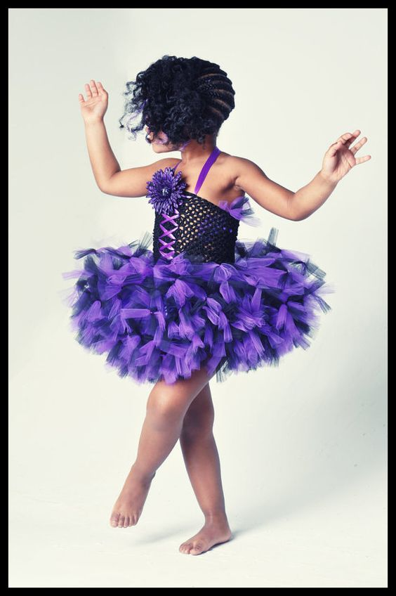 Welcome to Tutu Delicious Delights! This is a sassy purple and black petti tutu dress. It is full of purple and black tulle attached to a