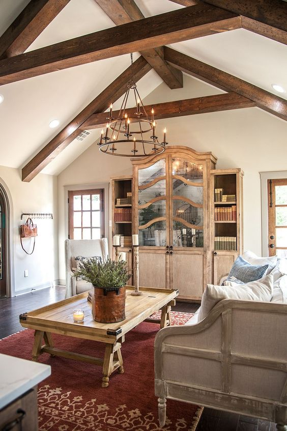 Custom armoire with antique mirror on doors, ceiling beams, and European farmhouse home decor in a room by Joanne Gaines of #fixerupper. #FrenchCountry