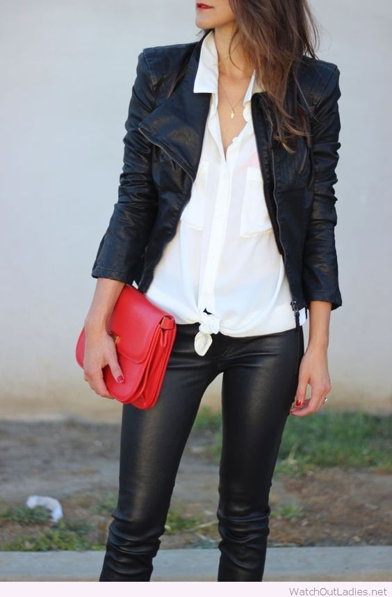 Black leather pants and jacket with white shirt and red bag: