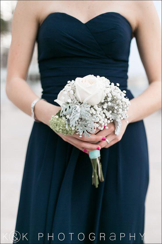 Bridesmaid bouquet - dusty miller, garden roses, babysbreath. Navy bridesmaids dress.       Love the dress!