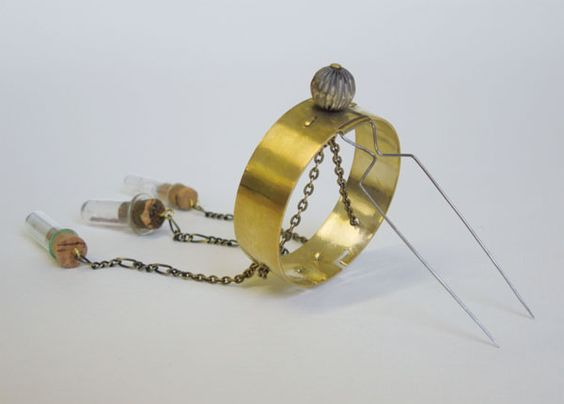Francesca Lobb, Manchester School of Art - 'Watchmaker's Brooch' - from 'Explore' Collection in brass, chain, stainless steel and corked glass vials