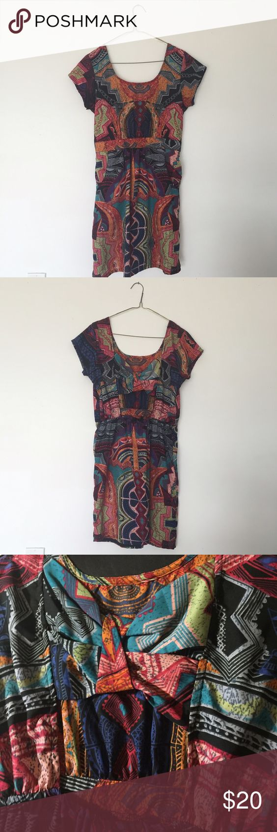 Multicolored Angie Dress from Macy's This is a multicolored Angie dress from Macy's. It has pockets, and an open cross-back design. Size small. 100% polyester. Only worn once, in like-new condition!! Macy's Dresses Mini