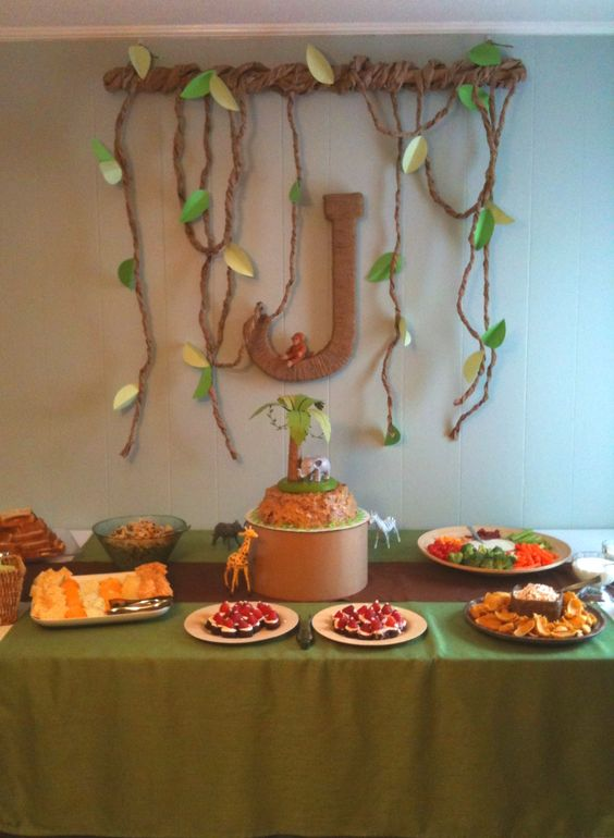 Jungle safari themed baby shower. Large paper mâché letter wrapped in twine. The vines were made from brown postal paper and scrapbook paper.: