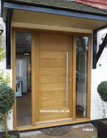 Contemporary front door with sidelights porch pillars for Front door patio ideas