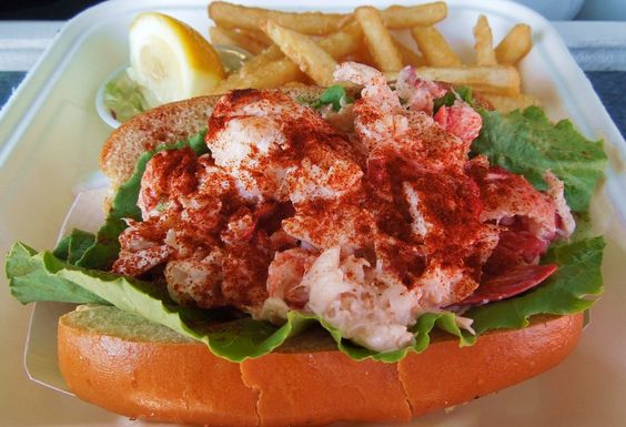 Chatham Pier Fish Market's lobster roll with its characteristic dusting of paprika on the top.