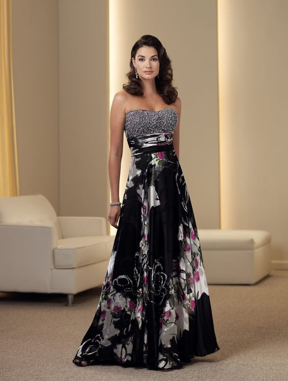 Strapless printed silk burnout A-line dress with softly curved neckline, Empire bodice encrusted with hand-beading, ruched midriff, bias cut skirt. Removable straps included. Sizes: 4 – 20