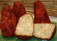 Boulette d'Avesnes (France) soft, mild, covered with parsley, tarragon, pepper and paprika